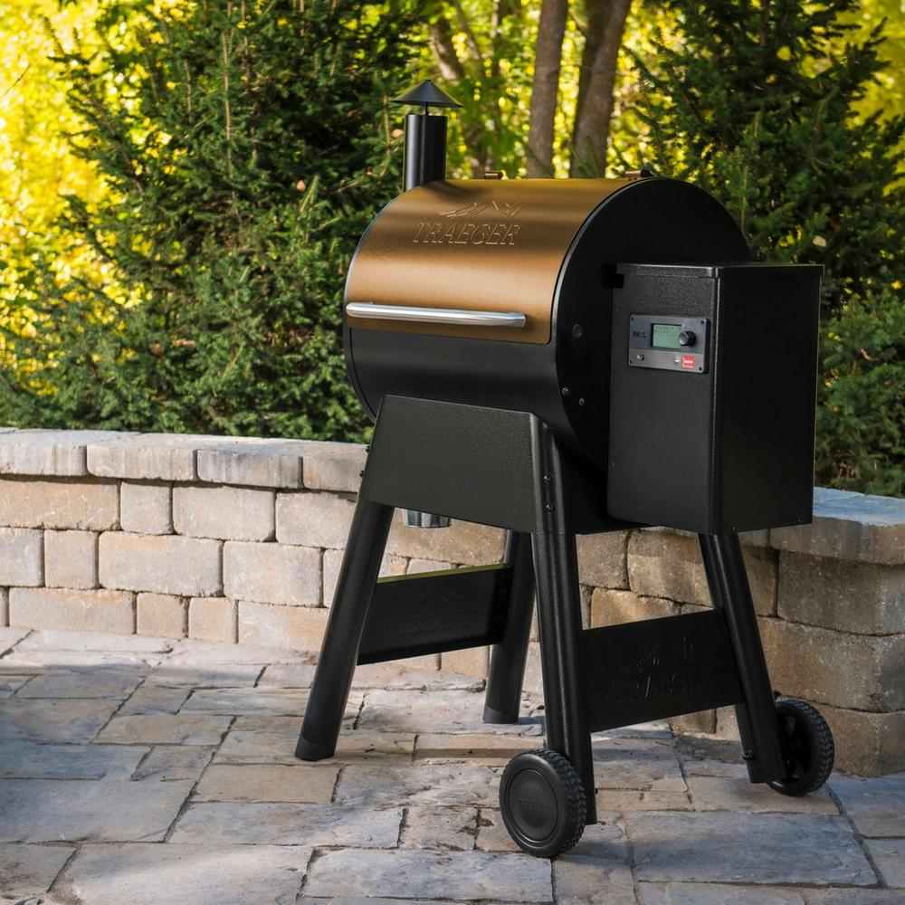 Traeger Pro 575 Bronze pellet grill on outdoor patio