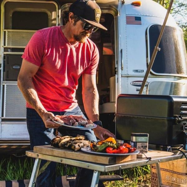 Man using Best outdoor grill Traeger Ranger Grill