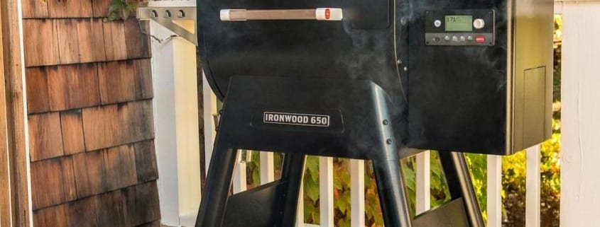 Traeger Ironwood 650 pellet grill being used on deck